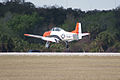 North American T-28B Trojan Navy N63NA Landing 07 TICO 13March2010 (14619577783).jpg