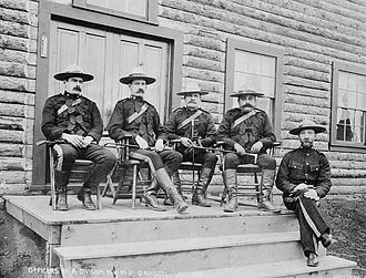 Zachary Taylor Wood - North-West Mounted Police (now RCMP) officers, Yukon, 1900, wearing the famous scarlet uniform that includes a flat brimmed Stetson hat.