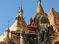 Old Bagan, Myanmar, Dhammayazika Buddhist Pagoda, golden shrines, cones, and Buddha images.jpg