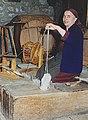 Old woman behind spinning wheel in Greece.jpg