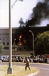 Onlookers watch in amazement, as firefighters struggle to contain the fire, after the hijacked American Airlines Flight 77 crashed into the Pentagon, during the terrorist attacks on September 11, 2001 010911-F-PD956-009.jpg