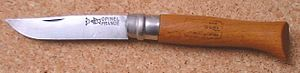 Opinel knife - No. 10 Opinel knife with carbon steel blade, Virobloc twistlock, and beechwood handle