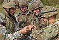 Oregonian ARNG soldier shares Tootsie Roll with JGSDF soldier, October 2006.jpg