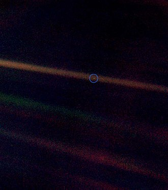 An Inconvenient Truth - The Pale Blue Dot, a Voyager 1 photo showing Earth (circled) as a single pixel from 4 billion miles (6.4 billion kilometres) away, is featured in the film. Al Gore points out that all of human history has happened on that tiny pixel, which is our only home.