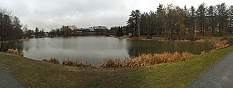 "Campus of Bates College - Lake Andrews, sometimes referred to as the ""Puddle"", is at the center of the college; directly center of the Lake is the Olin Arts Center"