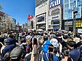 Passers-by in Shinjuku watch Reiwa period announcement (1 April 2019).jpg