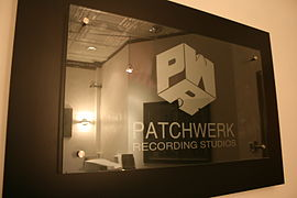 A picture of the Patchwerk sign hanging in the entrance of the studios.