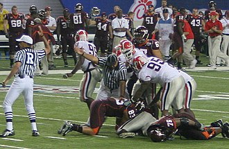 2006 Chick-fil-A Bowl - Referees sort out possession after a fumble