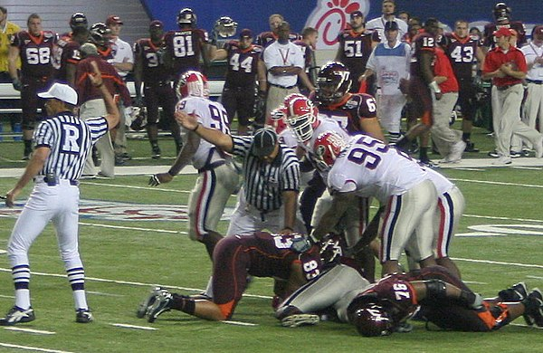 Officials sort out possession after a fumble at the 2006 Chick-fil-A Bowl between Georgia and Virginia Tech. Peach Bowl fumble aftermath.jpg