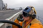 Peleliu conducts flight deck fire drill 120824-N-HF252-046.jpg