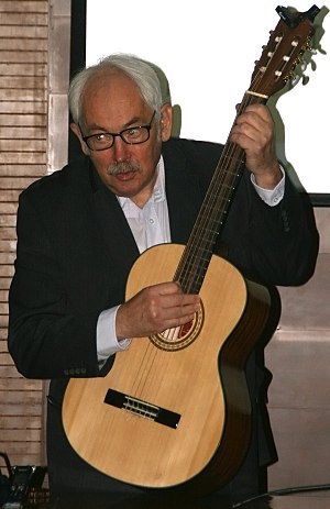 Peter Grünberg - Peter Grünberg playing guitar during his speech.