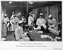 Photograph of a bandaging class at Tredegar House. Wellcome L0017617.jpg