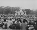 Photograph of battleship mock-up and crowds assembled for ceremony honoring Admiral Chester Nimitz. - NARA - 199209.tif