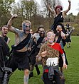 Picts (Two Left Feet) cheer on a child runner at the Roman vs Picts 5k race, Callendar House.jpg