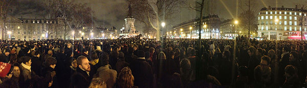 Crowds of people gathered at night to pledge solidarity to liberal French values after the Charlie Hebdo shooting.
