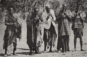 Music of Cameroon - Lela celebrations in Bali, Cameroon, around 1908. Four men play on holy lela flutes. The celebrations are directed by members of the Bali royal family.
