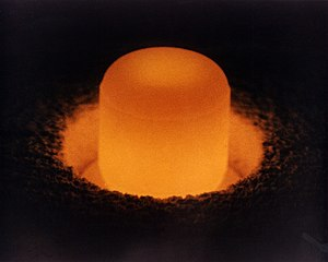 Plutonium(IV) oxide - A pellet of PuO2 glows from the decay of isotope plutonium-238 it contains