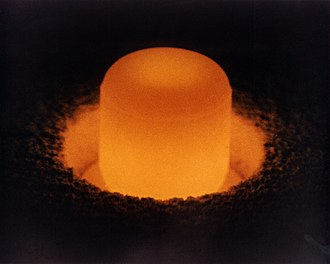 Plutonium-238 - Plutonium-238 oxide pellet glowing from its self-heating