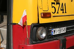 Polish flag on a Ikarus bus in Warsaw during a national day of mourning