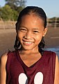 Portrait of a smiling girl with wet face at golden hour in Laos.jpg