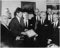 President Kennedy is presented AAU Life Membership Plaque. (L-R) Ed Rosenblum, Chairman AAU Life Membership... - NARA - 194175.tif