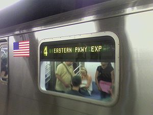 New York City Subway nomenclature - An R142 side sign indicating that this 4 train runs express on the IRT Eastern Parkway Line