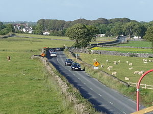 R348 road (Ireland) - R348 Southwest of Athenry. Looking towards the town (note the parish church in the left-background).