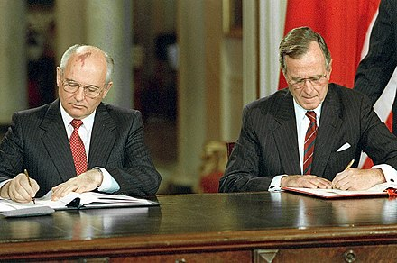 Mikhail Gorbachev and George H. W. Bush signing bilateral documents during Gorbachev's official visit to the United States in 1990 RIAN archive 330109 Soviet President Mikhail Gorbachev and U.S. President George Bush.jpg
