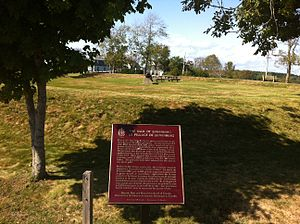Raid on Lunenburg, Nova Scotia (1782) -  Raid on Lunenburg (1782) – National Historic Sites of Canada Plaque with earthworks of Blockhouse Hill in background, Lunenburg, Nova Scotia