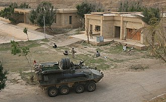 History of Iraq (2003–2011) - Marines from D Company, 3rd Light Armored Reconnaissance Battalion guard detainees prior to loading them into their vehicle