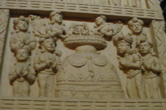 Blessing - Replica of an image at the Sanchi gate at Chaitya Bhoomi, which shows a devotion scene involving a Buddhist stupa.
