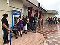 Residents of Ponce, Puerto Rico, line up at an ATM in hopes of getting some cash. More than a week after Hurricane Maria struck, residents are waiting in long lines to withdraw money and for gasoline.jpg