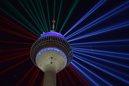Rheinturm Dusseldorf 70th Anniversary of the state NRW Illumination with Rheinkomet, including a real comet at the right side Rheinturm Dusseldorf NRW mit Sternschnuppe.jpg