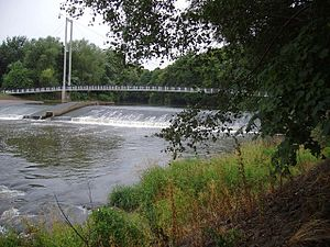 River Taff - A weir and footbridge (Blackweir Bridge) over the River Taff (Cardiff)