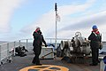 Royal Canadian Navy Leading Seaman Toni Filipovic calls the bridge as Ordinary Seaman Katherine Aitken and Able Seaman Ryan Nicholson support anchor weighing operations as the maritime coastal defense vessel 120504-N-IL267-006.jpg