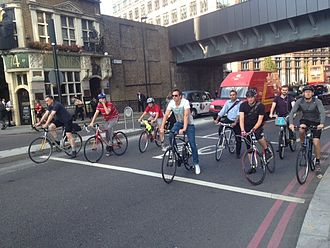 Cycling in London - Utility cyclists during rush hour in the City.