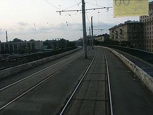 Trams in Saint Petersburg - Tram tracks span the viaduct over the Avtovo railway station.