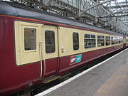 A Class 156 train in SPT livery at Glasgow Central station