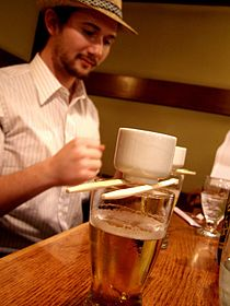 Sake bomb - man pounds table with fist.jpg