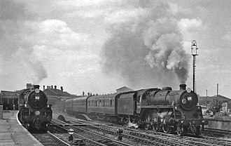 BR Standard Class 4 2-6-0 - 76064 (left) and 76065 (right) and Salisbury in 1963.