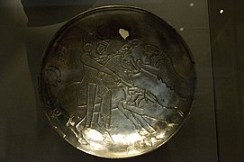 Sassanid silver plate depicting a lion hunt by Nickmard Khoey.jpg
