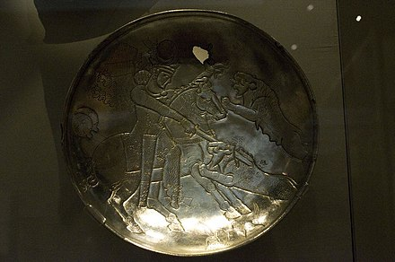 A Sasanian silver plate depicting a royal lion hunt Sassanid silver plate depicting a lion hunt by Nickmard Khoey.jpg