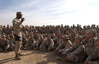 John L. Estrada - Estrada orating to U.S. Marines at the Iraqi city of Fallujah in 2005.