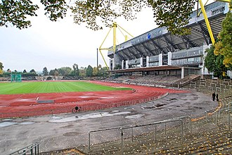 The Stadion Rote Erde, home of Borussia Dortmund from 1937 to 1974. The Westfalenstadion situated beside it features the largest terrace in Europe. Signal Iduna Park 2013 by-RaBoe 57.jpg