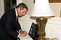Sloan Gibson, the president of the USO and Evening Parade guest of honor, signs a guest book during the parade reception May 24, 2013, at the Home of the Commandants in Washington, D.C. Evening Parades 130524-M-MM982-003.jpg