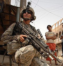 U.S. Army Spc. Joshua Rachal, from 2nd Platoon, Alpha Company, 1st Battalion, 502nd Infantry Regiment, 2nd Brigade Combat Team, 101st Airborne Division provides security, armed with an M249 squad automatic weapon during a patrol of the Hariyah district of Baghdad, Iraq, Aug. 30, 2008. (U.S. Army photo by Spc. Charles W. Gill, Released)
