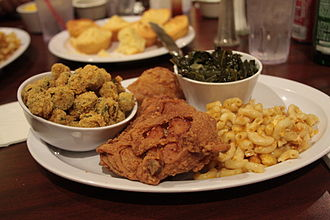 A traditional soul food dinner consisting of fried chicken with macaroni and cheese, collard greens, breaded fried okra and cornbread. Soul Food at Powell's Place.jpg
