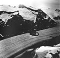 South Sawyer Glacier, mountain glaciers and hanging glaciers, rockslide on tidewater glacier, August 27, 1968 (GLACIERS 5899).jpg