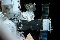 A Space Shuttle Atlantis out-the-window view showing a Soyuz spacecraft docked with Mir