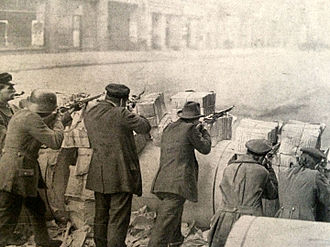 German Revolution of 1918–19 - Soldiers stand behind a barricade during the Spartacist uprising.
